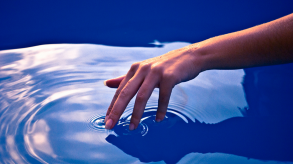Hand Touching Water HD